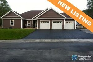 NEW LISTING! Custom open concept, attached 3 car garage