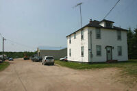 100 Acres, House and Large Three Bay Insulated Garage