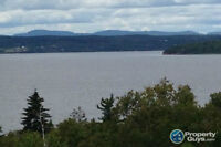One of a last remaining water view lots in the Highlands