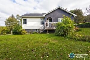 Conveniently located 4 bed/2 bath with in-law suite & waterview