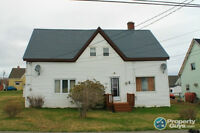 Ideal investment property with a duplex and 7 lots of land.