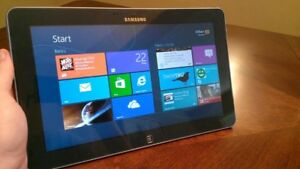 Two Samsung ATIV Smart PC 500T 11.6-Inch Touchscreen tablet.