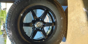 RSSW black alloy wheels with Cooper Discoverer A/T W tires