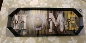 Brand new in box. Key hanging home sign
