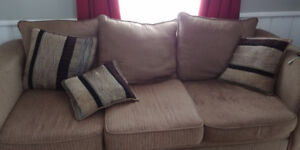 Free sofa, chair and a half and ottoman with cushions