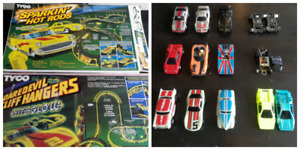 9 Tyco slot cars 2 sets parts all cars running well