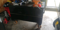 Black rolling tool box / bench with vice