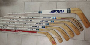 Masters of hockey autographed sticks