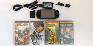 PSP 1000 Black 1GB + SNES/SEGA/NES + EXTRA BATTERY + 4 GAMES