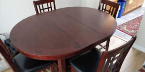 Expandable dining room table with storage + 4 chairs
