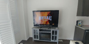 """52"""" SONY BRAVIA LCD TV with Fireplace Stand Unit @ $750 O.B.O"""