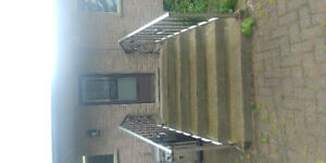 Free Concrete Stairs with Stainless Steel Railing.