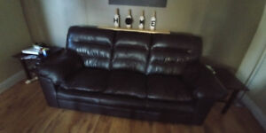 Leather brown sofa and rocker recliner