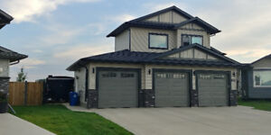 Blackfalds Home for Sale - Almost Half Acre in Town!