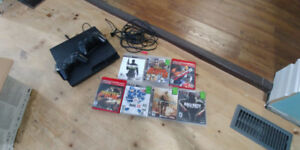 PlayStation 3 (PS3) with 6 games, 2 controllers