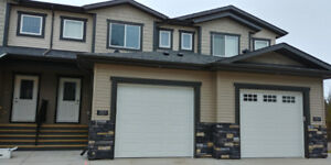 Semi-furnished one bedroom walk out basement in a new townhouse