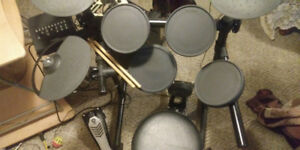 digital drum set in good condition. Year-and-a-half-old bought