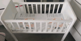 White Mothercare Crib with new mattress and crib bedding set.