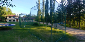 Batting cage and pitching machine
