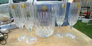 crystal decanter and four champagne flutes