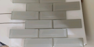 Leftover glass mosaic tiles and 3x6 white ceramic wall tiles