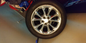 Chrome rims with tires .need gone