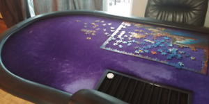 Poker table with chair and framed poker poster