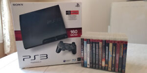 Ps3+ 1 manette+ 14 jeux + kit rock band 2 (guitar, drums, micro)