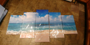 Brand new in plastic beach canvas paintings