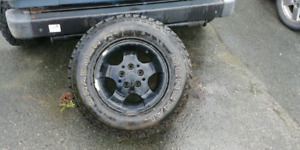 4 tires and rims off 01 jeep tj