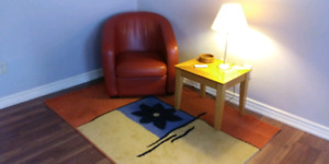 Chair, table, rug and lamp.