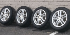 4 mags 16 inch with Bridgestone summer tires 205/55 R16