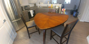 Solid wooden pub height table with 4 chairs