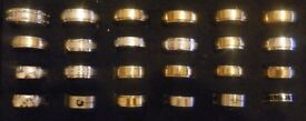 A selection of 24 Mens dress rings up to size Z+2
