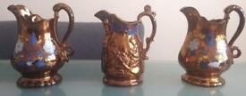 Three 19th c Lustre copper jugs