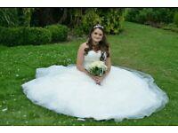 A beautiful ivory Princess style Mori Lee wedding dress by Madeline Gardner