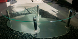 Glass coffee table with shelves