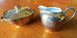 Vintage silverplated porcelain cream & sugar set.