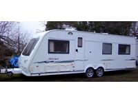 COMPASS RALLYE 640 TWIN AXLE + NEW MOTOR MOVER. FIXED BED (end bedroom), 2004