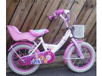 Girls 14 inch bicycle perfect condition seldom used £40 .