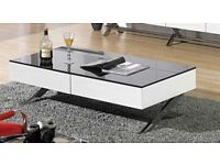 Large white high gloss coffee table with black glass top