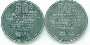 2 JETONS DE 50 CENTS DE COCA COLA ET MC DONALD DE 1983