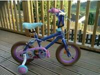 Girls frozen bike with stabilisers helmet elbow and knee pads