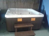 Brand new mega spa compact 2 year warranty and delivery included