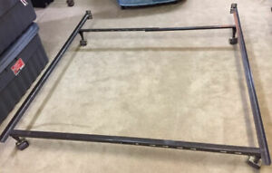 Metal bed frame adjustable to queen size