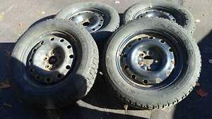4 FIRESTONE WINTERFORCE TIRES ON RIMS