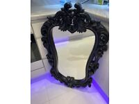 Black ornate mirror.