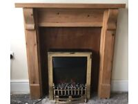 Solid pine fire surround and electric fire