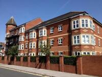 2 bed apartment,2 bathrooms, parking, close to transport Sale town centre and the M60 motorway