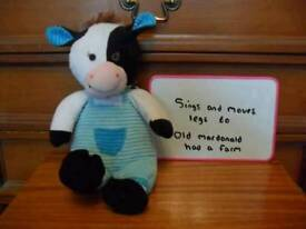 Singing and moving toy cow